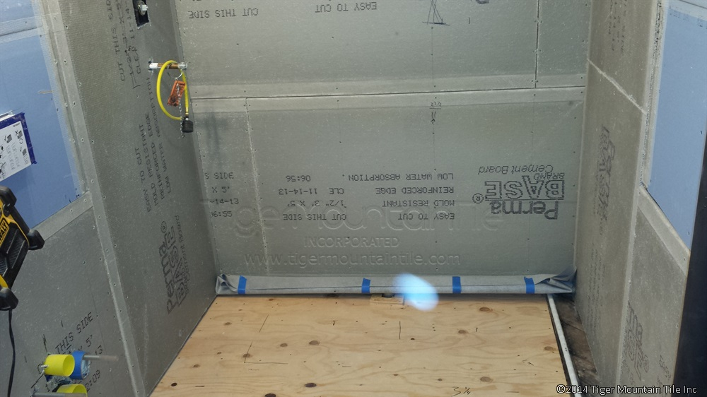 cement board is being installed on walls