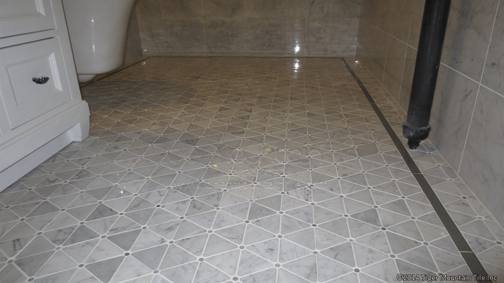Curbless Carrara shower with linear drain in Seattle Washington