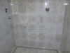 Carrara Marble shower with linear drain