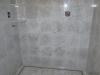 Carrara Marble shower with linear drain