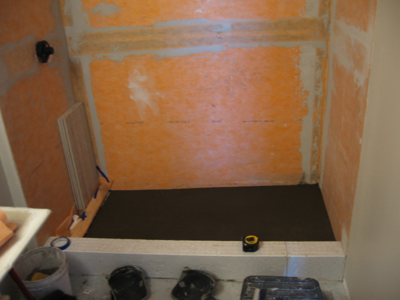 Schluter Kerdi fabric is installed on walls and mud bed installed