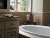Issaquah Highland\'s Harrison Street Master Bathroom tub back splash