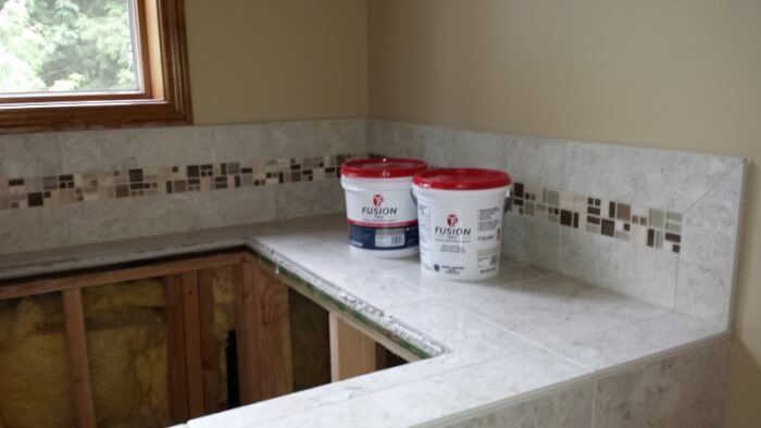 Stain proof Custom Fusion grout in Sammamish master bathroom tile not urethane